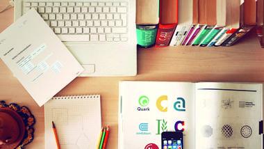 Students work desk. Photo.