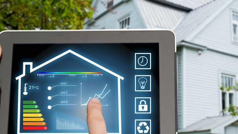 A screen measutring the energy and the temperature in a house. Photo.