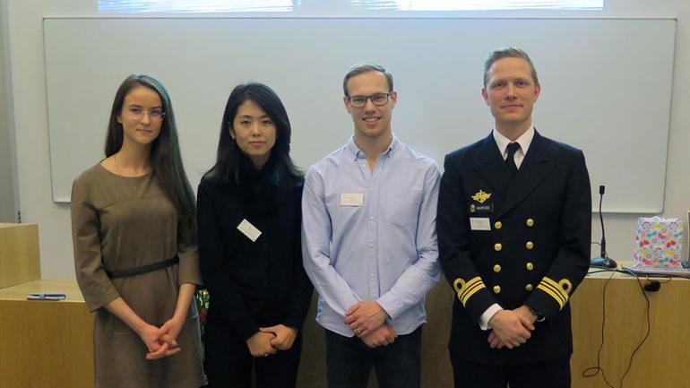 Fire Phd. studenter på doktorgradsutdanningen i nautiske operasjoner.