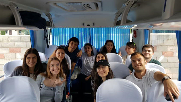 Students gathering in the bus