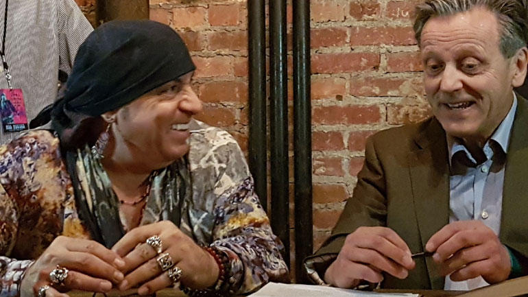 Steven Van Zandt and Geir Salvesen signing backstage in New York.  Photo: Norway Communicates