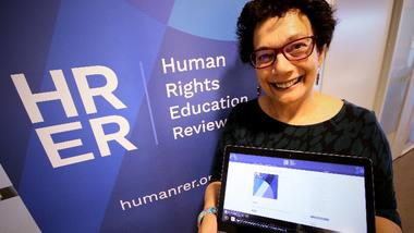 Audrey Osler at USN showing the Human Rights Education Review journal. photo.