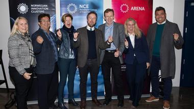 USN blir forskningspartner på to nye Arena-prosjekter. Gruppebilde med næringsministeren.