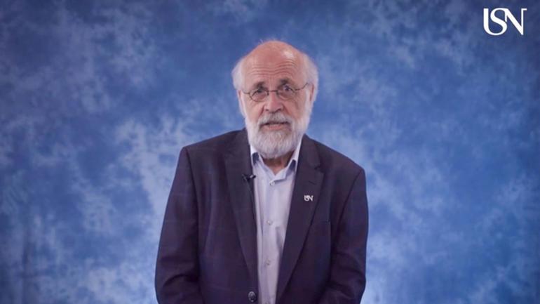 Rektor Petter Aasen talte til avgangsstudentene på USN via en forhåndsinnspilt video. Skjermdump