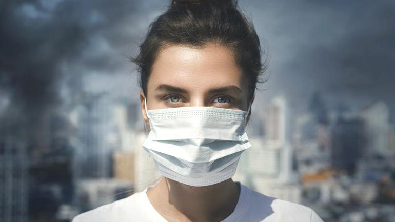 En student med munnbind - illustrerer at vi trenger klimarådgivere